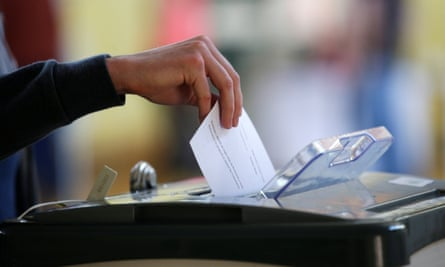 A voter casts their ballot in a referendum in Dublin, Ireland.
