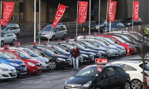 Cars are displayed for sale on the forecourt of a Vauxhall dealership on January 8, 2014 in London, England.