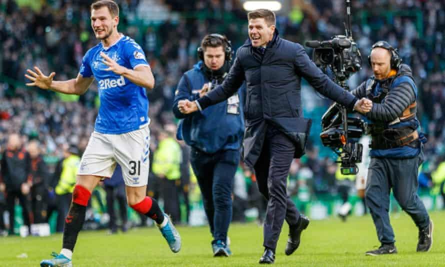 Steven Gerrard and Borna Barisic celebrate the win at Celtic Park