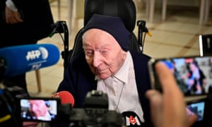 Lucile Randon talks with journalists during an event to celebrate her 116th birthday last year.
