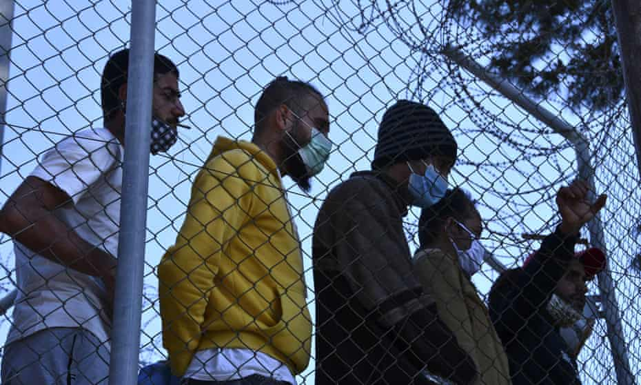 Migrants inside the old refugee camp on the island of Samo