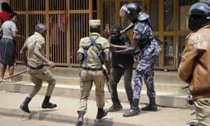 Ugandan security forces detain a protester in Kampala on Monday.