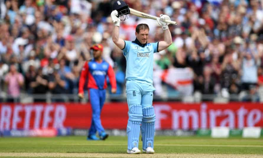 Eoin Morgan holds his bat aloft after reaching his century in magnificent style.