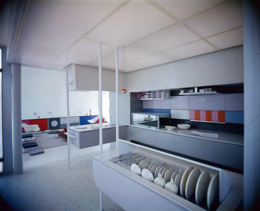 Interior view of the kitchen in the House of the Future attraction, exhibited at Disneyland, Anaheim, California, from 1957 to 1967. The experimental structure was conceived jointly by architects at MIT (Massachusetts Institute of Technology), the Monsanto Chemical Company, and the Walt Disney Imagineering team; it consisted of 20 molded pieces of fiber-reinforced plastic held up by a 16 square foot block of concrete and featured innovations such as a dishwasher, a microwave, and molded plastic furniture.