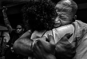 Man hugging women.