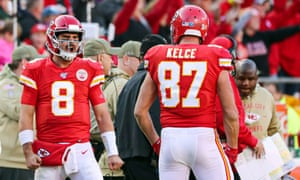Matt Moore (8) celebrates with tight end Travis Kelce (87) after defeating the Minnesota Vikings