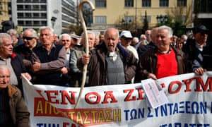 Pensioners protest in front of Athens city hall against pension cuts and tax changes.