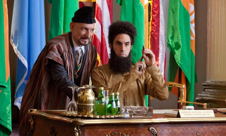 With Ben Kingsley in the film The Dictator, in which Sacha Baron Cohen plays Admiral General Aladeen, a character based on Muammar Gaddafi.