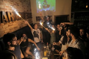 People celebrate a friend's birthday in Marionette bar in the Old City.