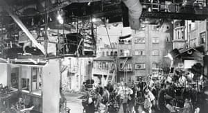 Rear Window (1954) The film was shot on a single set and this image gives some idea of the technology and number of people involved in the production. Hitchcock is in the centre watching James Stewart on the far left.