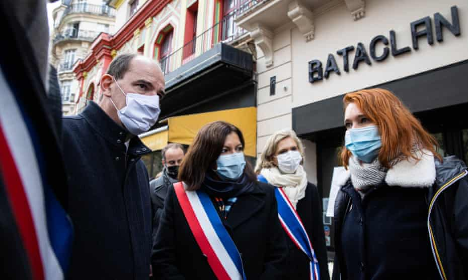 French prime minister, Jean Castex, and Paris mayor, Anne Hidalgo, pay tribute outside the Bataclan concert venue.