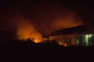Forest fires blaze near a house in Kapuas
