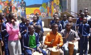 Children take part in the music programme at Magoso school in Kibera.