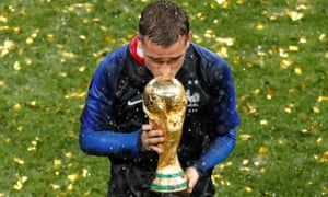 Antoine Griezmann kisses the World Cup trophy