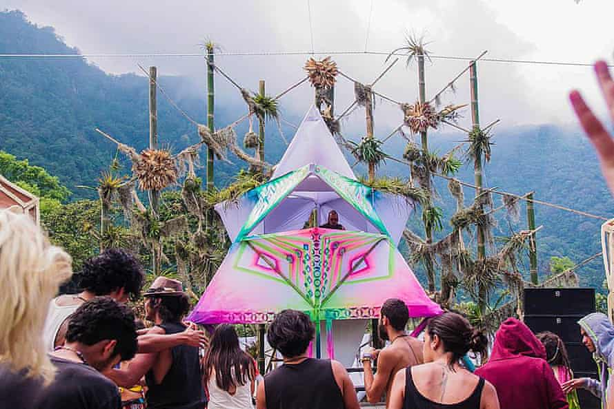 A DJ plays to a small crowd of partygoers at Cosmic Convergence, Lago Atitlan, Guatemala.