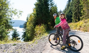 mother and daughter  mountain biking near Belis Fantanele Lake, Transylvania
