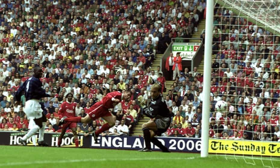 Jamie Carragher heads the ball into his own net against Manchester United at Anfield.