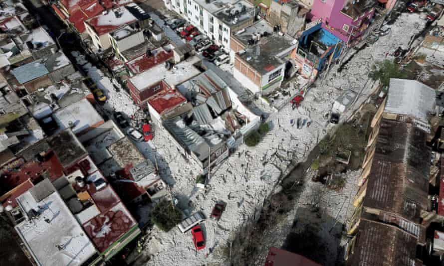 Aerial view of vehicles buried in hail in the streets in the eastern area of Guadalajara