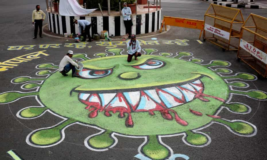 Coronavirus artwork painted on a road in Bhopal, India, depicting its distinctive 'spikes'