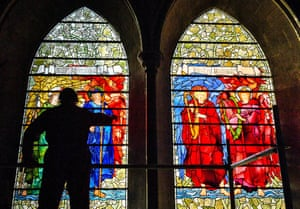 Salisbury, England A conservator inspects the Angeli Laudantes and Angeli Ministrantes stained glass windows at Salisbury Cathedral as restoration work gets under way