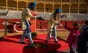 Pages from the Three Magic Kings 'Tres Reyes Magos', (also known as the Three Wise Men) receive a letter from girls at Aranjuez's bullring as an alternative to the traditional parade in an attempt to observe health safety measures against coronavirus
