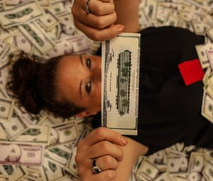 Jessica King, one of the student strikers, holds fake money that asks: how far to free?
