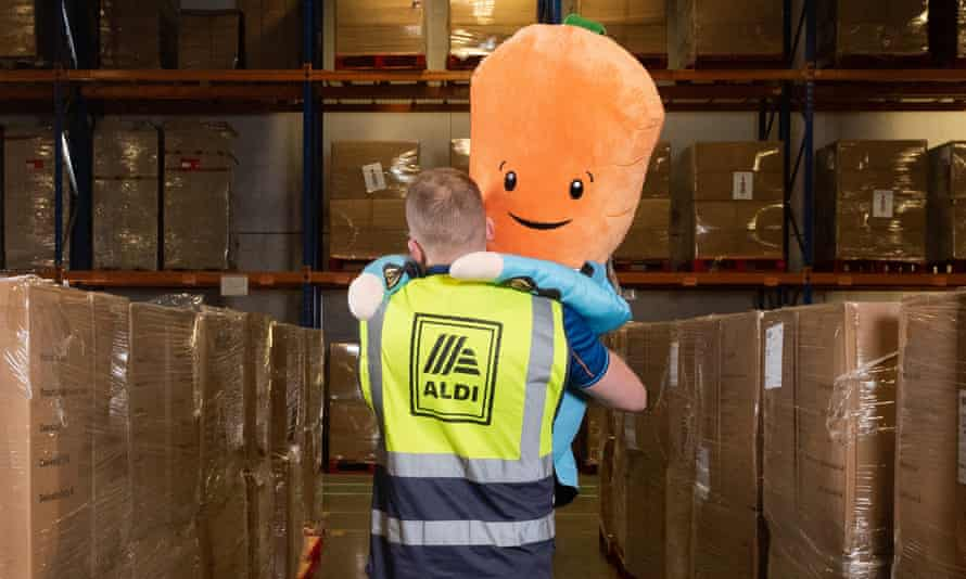 Aldi's Kevin the carrot toy is carried in a warehouse