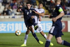 John McGinn put Scotland back in front with a controlled finish.