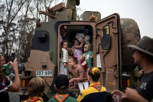 Children play inside an Australian Army forces vehicle helping with bushfire recovery in Cobargo, NSW on 12 January 2020.
