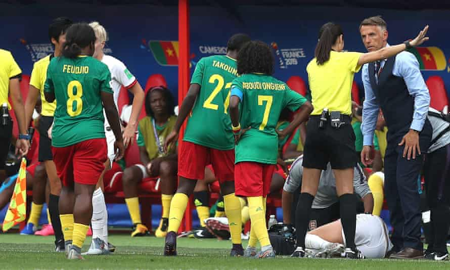 Phil Neville confronts the referee after another heavy Cameroon challenge, this time on England captain Steph Houghton.