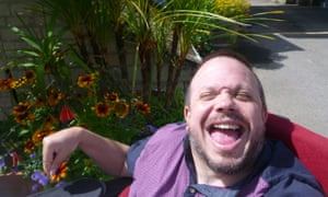 A Leonard Cheshire service user enjoys the garden at Greenhill House in Somerset. The UK's disabled people are in danger of being 'forgotten', says the charity's chief executive.