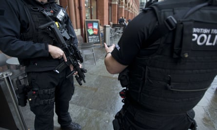 Armed British police officers stand guard