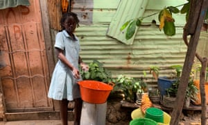 A child at a wash basin in Povoado