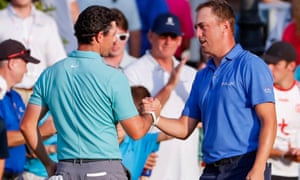 Rory McIlroy and Justin Thomas at the end of their second round.
