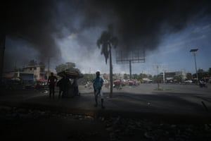 Smoke from burning tyres lit by protesters hangs over  Port-au-Prince, Haiti.