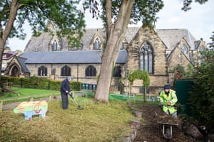 Stephen Woodrow and Mike Rudd tend to the garden of St Stephen's church, Bradford.