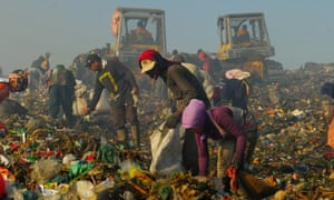 People scavenge at a rubbish tip in Medan. Some 93 million Indonesians are living below the World Bank's 'moderate' poverty line of $3.10 a day.