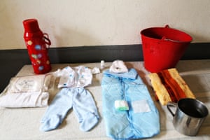 Marie Lucette's bag: thermos, bucket, baby clothes, cup, nappies, cloth