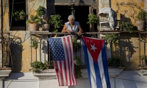 Javier Yanez stands on his balcony where he hung a US and Cuban flag in Old Havana Cuba on Friday.