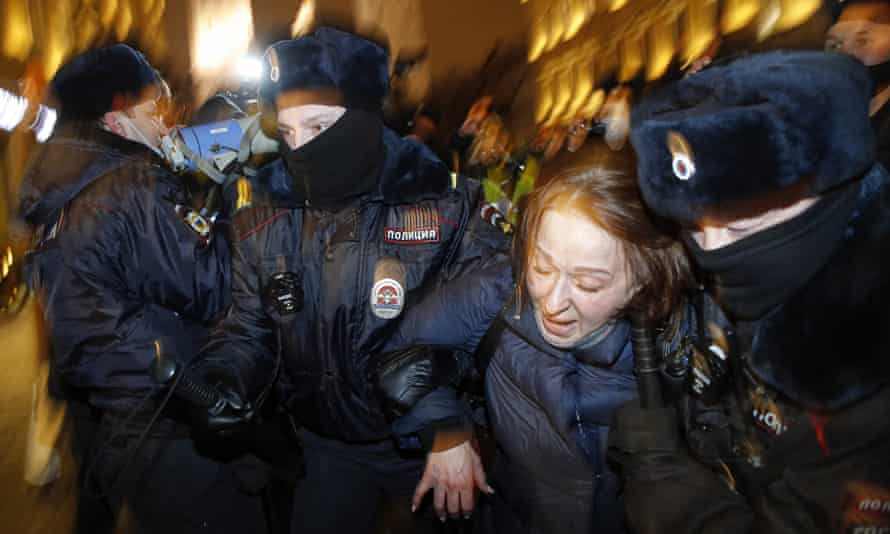 Police officers detain a supporter of opposition leader Alexei Navalny during a protest in St. Petersburg, February 2021.
