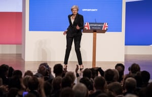 May gets in on the joke about her dancing, by doing more dancing as she as she takes the stage to give her keynote address at the Conservative Party conference in October 2018