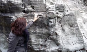 The Cornwall Association of Local Historians has criticised a carving of Merlin in the rocks at Tintagel.