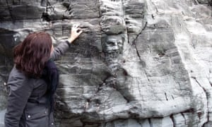 The carving of Merlin's face in the rock