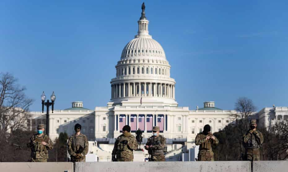 National guard soldiers stand guard on the grounds around the US Capitol building in Washington DC ahead of Joe Biden's inauguration as the nation's 46th president.