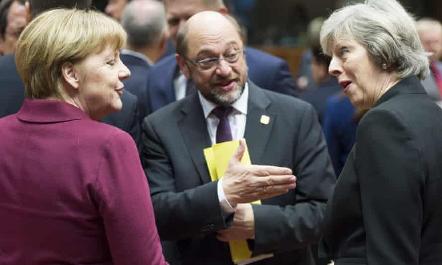 Theresa May with Angela Merkel and Martin Schulz, the European parliament president.