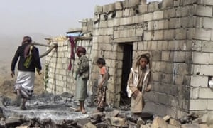 Residents inspect a house that was damaged during a 29 January US raid on the tiny village of Yakla, in central Yemen.