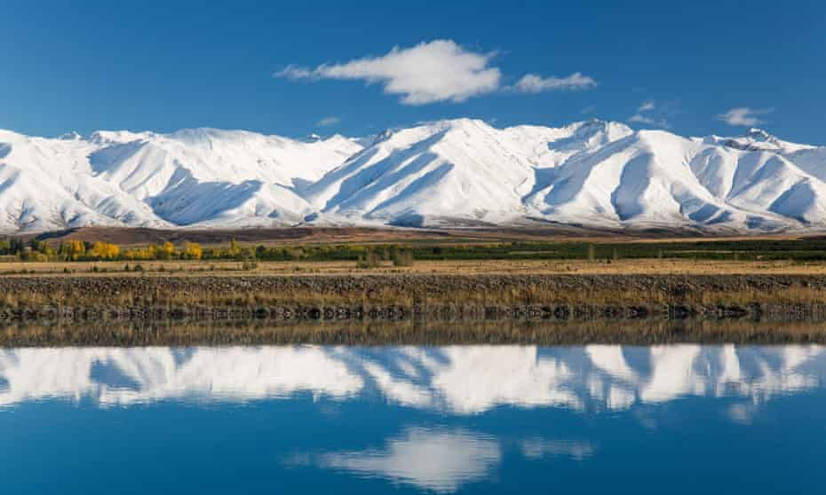 The Ben Ohau mountain range rises above Lake Pukaki and the Pukaki Canal near Twizel in the heart of the Mackenzie district of New Zealand's South Island.