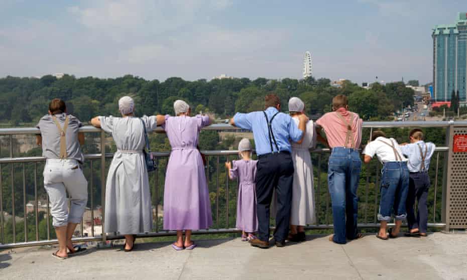 Mennonites at Niagara Falls looking out at Ontario.