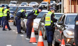 Police in Albury check cars crossing the NSW border from Victoria after authorities closed the border due to an outbreak of Covid-19 coronavirus in Victoria