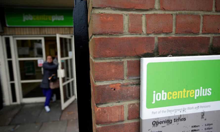 Woman exiting a UK jobcentre